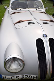 """A Day at the Pebble Beach Concours d'Elegance Car Show - Photo 5 of 9 - In 1939, Carrozzeria Touring in Milan built this """"superleggera"""" body on a BMW 328 chassis to be used for long-distance racing. Its lightweight and aerodynamic shape allowed it to hit a top speed of 137 and completed the 24 Hours of Le Mans race in 1939."""