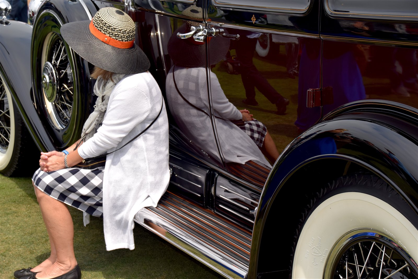 The experience would not have been complete without a wide array of attendees—all hailing from various backgrounds from all over the world. We had to capture this moment with one of the car's owners.  Photo 10 of 10 in A Day at the Pebble Beach Concours d'Elegance Car Show