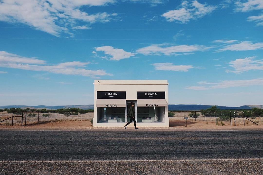 After being recovered from its fair share of vandalism, Prada Marfa has become a permanent part of the Texas landscape. Though the structure lacks a real door, the two large windows are filled with actual shoes and bags by Prada.  Photo 2 of 2 in A Collision of Art, Architecture, and Fashion in Marfa