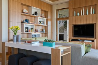 Dwell Home Tours Lands in Silicon Valley - Photo 8 of 15 - Throughout the house, you'll find steel windows with wood cladding. Foldaway doors also make appearances throughout the residence, creating an open feel. The interiors were designed by Lorissa Kimm.