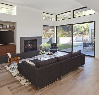Dwell Home Tours Lands in Silicon Valley - Photo 14 of 15 - Williamson strategically placed the windows and clerestories to maximize daylight. A fireplace provides a warming focal point.