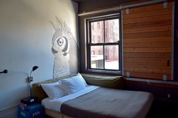 Art and Design Come Together in These 10 Examples of Inspirational Wall Murals - Photo 4 of 12 - Every room has a different setup, many of which include custom wall murals that are quirky and lighthearted. Industrial and rough details make you feel like youx2019;re camping, including wool quilts from Pendleton for the Ace Hotel, barn door sliding windows, heavy metal hardware, and old claw foot bathtubs.