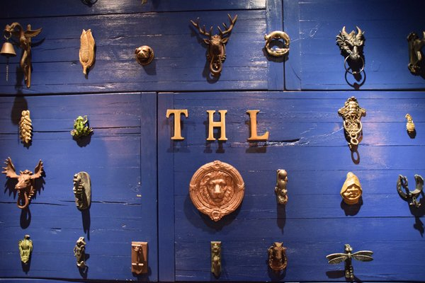 The first thing you'll notice when you walk in the space is the blue painted wall that's filled with a collection of door knockers. Owners Mellisa and David explained that the wood came from old rotting table tops that they let dry for two months before painting them blue and posting them up on the wall. They've collected the door knockers themselves at flea markets throughout their travels. Each one means something special to them.