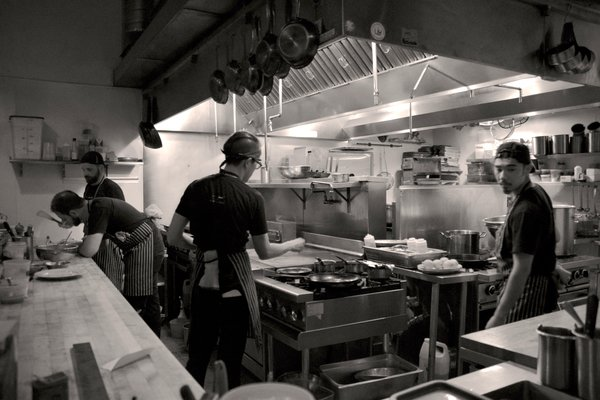 The tavern-like restaurant is dark and moody, while the open kitchen lights up the space from the corner. We spent some time watching the bustling team piece together their creations.