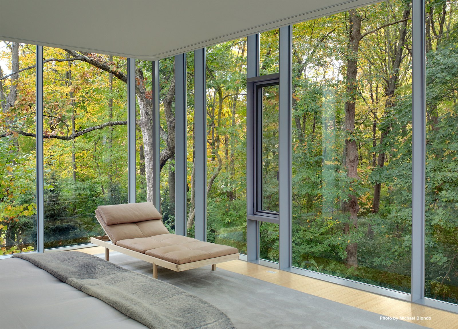In the master bedroom, Mori custom built a beveled edge bed with side drawers and lined with the windows with automatic curtains, both blackout and sheer.