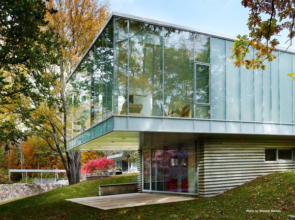 """Marcel Breuer's Revived Home Could be Yours for Just Under $5 Million - Photo 6 of 8 - Mori's addition is constructed of steel, concrete, glass, and a bluestone veneer. She decided to preserve the ceiling height of the main house (11'6"""") and lined the roof with Voltaic solar panels."""