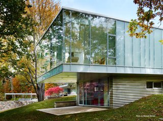 "Mori's addition is constructed of steel, concrete, glass, and a bluestone veneer. She decided to preserve the ceiling height of the main house (11'6"") and lined the roof with Voltaic solar panels."