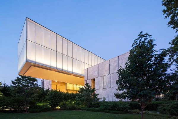 """Tod Williams Billie Tsien Architects (TWBTA) built a cantilevered rectangular box that hovers over a courtyard. The new site is known as the """"Gallery in a Garden."""""""