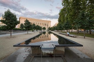 Attic Fire Photography stopped to capture the reflection of the Philadelphia Free Library on the Barnes Foundation's fountain.