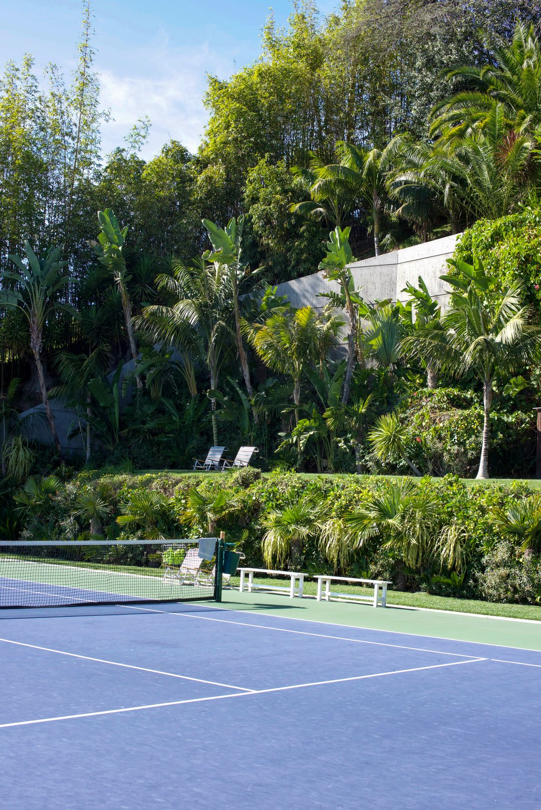 The colossal yard includes LA's only infinity tennis court and looks out to astonishing views.