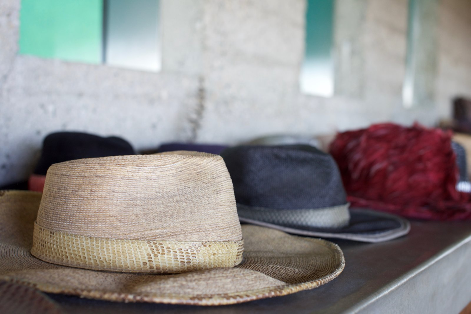 James Goldstein shows off his collection of hats on the concrete shelves in the bedroom.  Behind the Scenes at John Lautner's Sheats-Goldstein Residence by Paige Alexus
