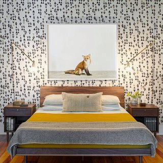 "12 ""Pro-Tips"" For Installing Wallpaper in Your Home - Photo 8 of 13 - The husband-and-wife team behind Rethink Design Studio sent us this bedroom shot from a home they designed for a family of four. They covered the bedroom wall with a bold patterned wallpaper from Hygge & West and finished it with artwork from the Animal Print Shop."