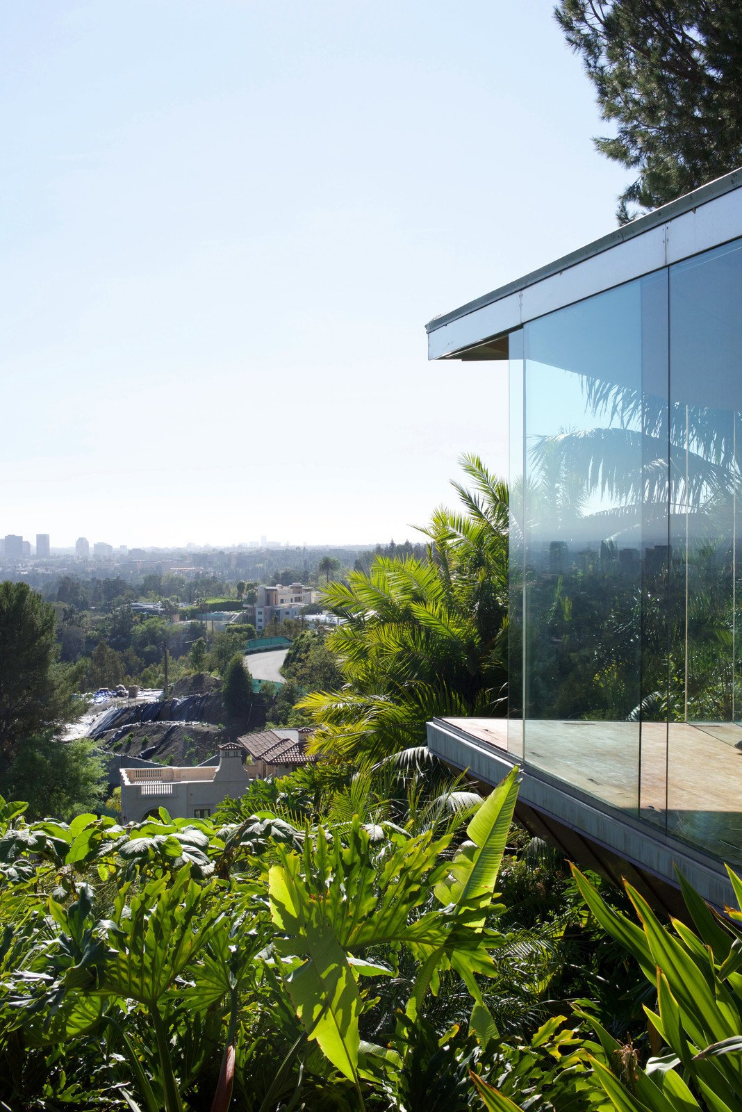 One of the first projects Goldstein and Lautner did together to renovate the house was implement seamless glass throughout the residence, which created a connection to the outdoors that remains consistent throughout the entire property. Many of the windows were updated to open automatically.  Photo 2 of 9 in Iconic Perspectives: John Lautner's Sheats-Goldstein Residence