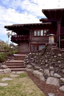 Iconic Perspectives: Greene & Greene's Gamble House - Photo 2 of 7 - Inspired by Japanese architecture, the Greenes ensured that there were no hard edges to be found on the property. Everything is round and smoothed out, including the bricks in the yard. The exterior of the house is lined with Douglas fir and the extended overhanging eaves act as cooling agents while protecting the porch from the rain.