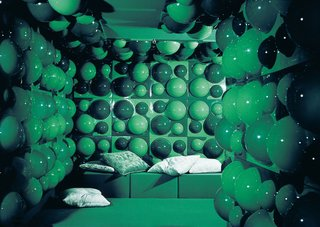 One of Panton's creations is shown here with a close-up of the wall elements produced by Harlacher for Visiona 2 at the 1970 IMM Köln Möbelmesse / Cologne Furniture Fair.