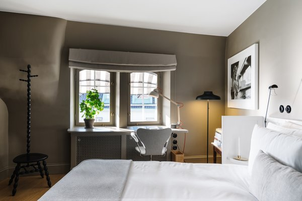 A Visual Journey Through Stockholm's Hotel Ett Hem - Photo 6 of 12 - In this bedroom on the top floor, a desk area overlooks the Östermalm neighborhood and is equipped with heated floors. Each room also has its own brass cocktail cabinet.