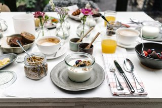 A Visual Journey Through Stockholm's Hotel Ett Hem - Photo 8 of 12 - A complimentary breakfast is served each day, which includes fresh yogurt, house-made granola, pastries, avocado toast, and cheese.