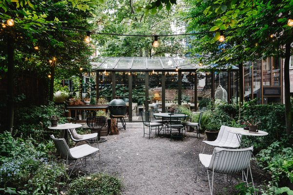 A Visual Journey Through Stockholm's Hotel Ett Hem - Photo 9 of 12 - You'll find outdoor seating and a fire pit in the courtyard. The hotel's chefs can be found here grilling for the evening meals.