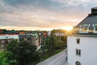 A Visual Journey Through Stockholm's Hotel Ett Hem - Photo 11 of 12 - This view highlights the sunset that can be seen from the rooms on the top floor, which overlooks the Östermalm neighborhood.