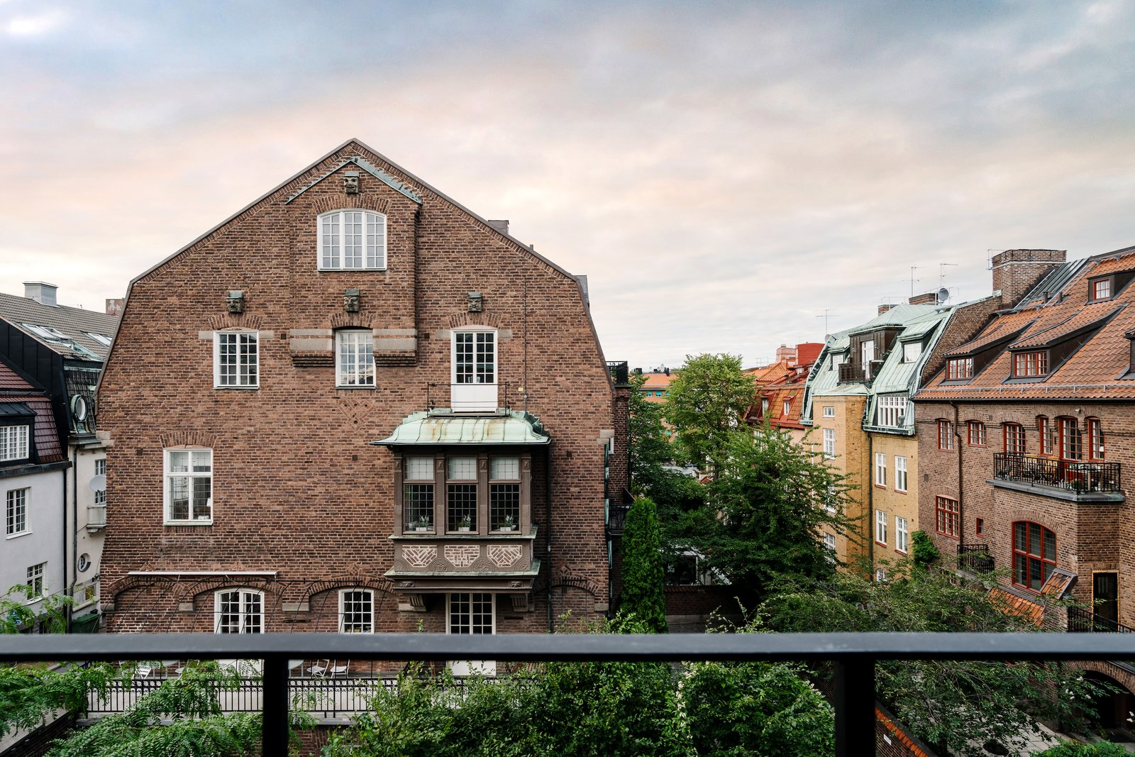 Shown here is the balcony view, seen from the second floor. The courtyard to the property sits directly below. A Visual Journey Through Stockholm's Hotel Ett Hem - Photo 13 of 13