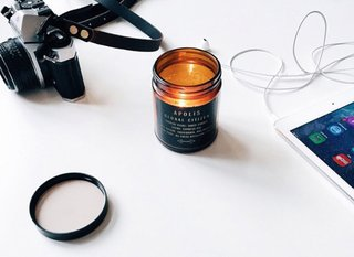 Stocking Stuffers That Will Please the Modernists in Your Life - Photo 10 of 11 - The portable design is perfect for bringing light (and a subtle cypress fig perfume) anywhere. Apolis Transit Issue Table Candle, $24
