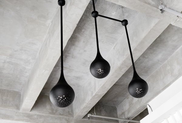 As the duo's first experiment with lighting design, each pendant was spun by hand in L.A. and has a custom perforated pattern that allows light to shine through.