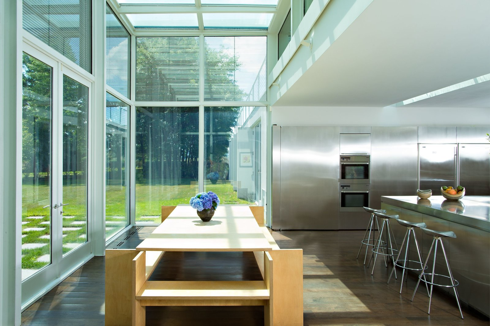 Adjacent to the reflecting pool is a chef's kitchen that's filled with expanses of stainless steel.