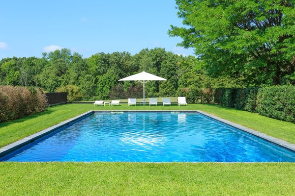 By following a pathway of Linden trees from the indoor pool, you'll find yourself at the outdoor pool.