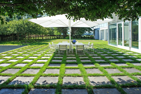 Dan Kiley filled the entire property with thoughtful landscape elements, including this patched concrete outdoor dining area.