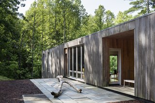 """The siding is made up of untreated cypress. You can see how each section has weathered differently, depending on how much exposure it's received since its completion in 2013.<span> <a href=""""/discover/dwelllpow"""" target=""""_blank"""">#dwelllpow</a></span>"""