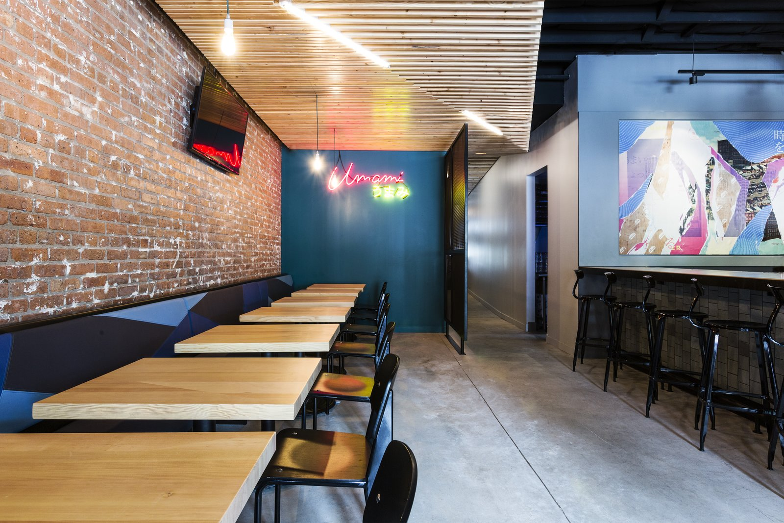 At this Chicago location, Project M Plus installed panels of custom wooden slats on the ceiling. The geometric shapes refer to the art of origami. A Popular Burger Joint Flaunts Its Roots With the Help of a Design Collective - Photo 3 of 9