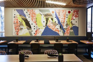 A Popular Burger Joint Flaunts Its Roots With the Help of a Design Collective - Photo 4 of 8 - The graphics team at Project M Plus created street-inspired décollage wall art for  both locations. Made popular by artists François Dufrene, Jacques Villeglé, and Raymond Hains, this technique is created by layering posters on top of each other, and then tearing away pieces to reveal what's below. This wall art (at the Santa Monica location) is inspired by Japanese graphics and slang—and also incorporates vintage postcards.