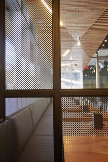 A Popular Burger Joint Flaunts Its Roots With the Help of a Design Collective - Photo 7 of 8 - In order to help create a bit of privacy in certain areas of the Santa Monica locale, they created perforated metal screens that were are by traditional shoji screens.