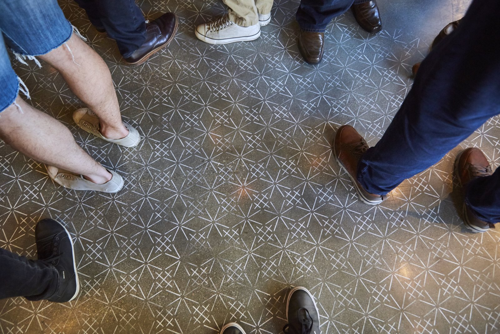 The stenciled floor takes cues from Sashiko embroidery textile designs. A Popular Burger Joint Flaunts Its Roots With the Help of a Design Collective - Photo 9 of 9