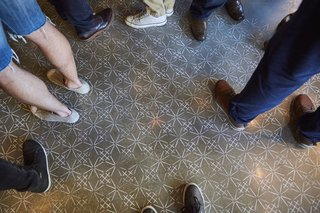 A Popular Burger Joint Flaunts Its Roots With the Help of a Design Collective - Photo 8 of 8 - The stenciled floor takes cues from Sashiko embroidery textile designs.