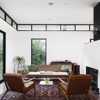 A Glimpse Into a Remodeled Midcentury Abode in Austin - Photo 2 of 4 - This photo that Calo took of the central living space is marked by tall ceilings, clerestory windows, and a cold-rolled steel fireplace.
