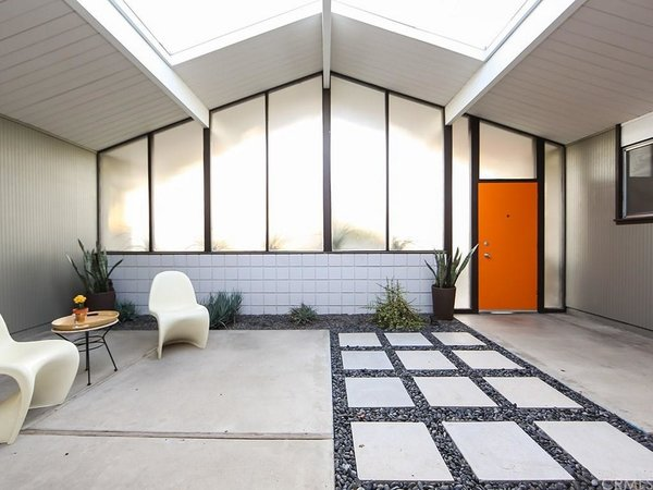 Many have come to see the inclusion of an atrium as a defining factor of Eichler–designed homes. Like many modern homes built in Southern California during this era, this space helped blur the lines between inside and out.  Photo 2 of 8 in This Quintessential Eichler Will Hit All Your Midcentury Goals—and It's For Sale