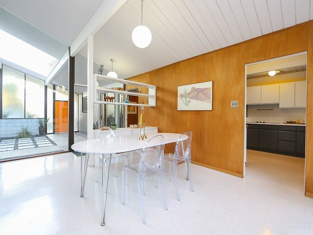 Like many Eichler-designed houses, he implemented Phillippine mahogany walls, which were kept original. The living spaces connect to the atrium from multiple glass-enclosed areas. This Quintessential Eichler Will Hit All Your Midcentury Goals—and It's For Sale - Photo 4 of 8