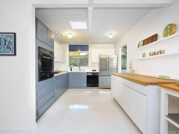 The kitchen is spacious and includes plenty of counter space to cook and entertain. Throughout the house, original radiant floor heating is still operable to this day. The surface has been updated with newer VCT flooring.