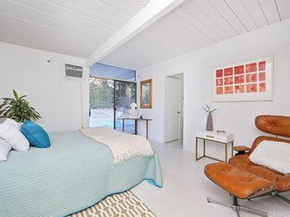 This Quintessential Eichler Will Hit All Your Midcentury Goals—and It's For Sale - Photo 6 of 7 - The house includes four bedrooms and two bathrooms, which have been updated. This bedroom exits directly onto the backyard patio.