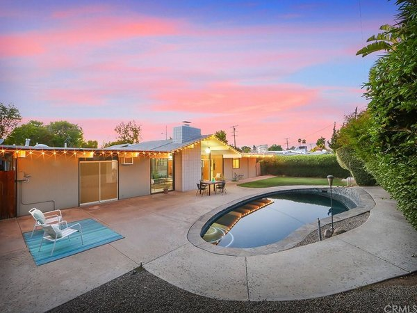 The bean–shaped pool and small grassy area would allow you to enjoy the Southern California climate year-round.