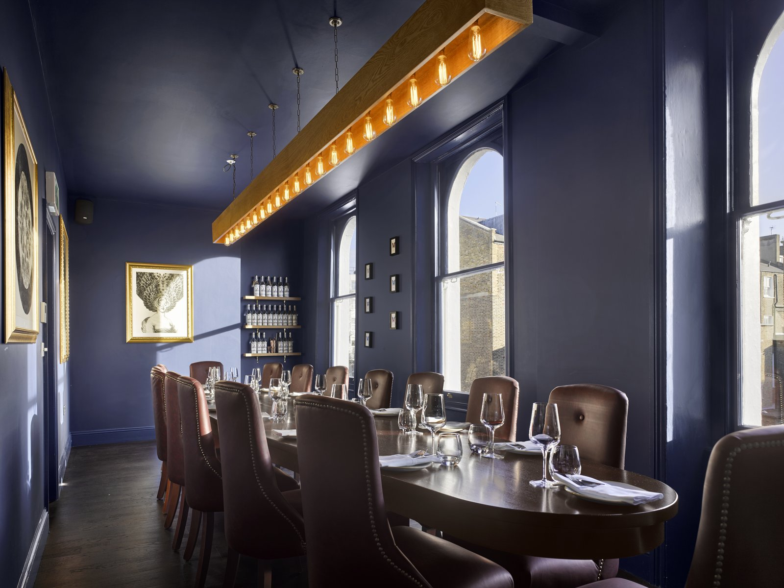 On the top floor, you'll find The Boardroom, a private dining room that holds its own private bar.  Photo 6 of 7 in Gin Enthusiasts Will Be Flocking to This New London Hotel