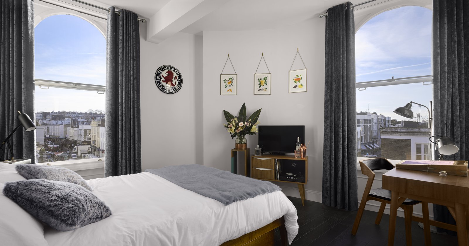 The three boutique guest rooms feature a combination of midcentury furniture and playful, spirit-inspired accents. Designed by each of the brand's founding directors, each room includes a minibar filled with spirits that were crafted on-site and a bespoke record player with a vinyl playlist that's been curated by Rough Trade Records.