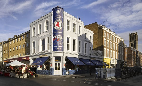 Gin Enthusiasts Will Be Flocking to This New London Hotel - Photo 1 of 7 - Located smack-dab in London's Notting Hill district, The Distillery sits on a bustling corner of the iconic market street and is marked by a classic, nostalgic facade.