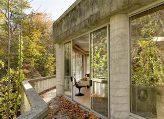 The One-of-a-Kind Home of the Late Architect John Black Lee Drops to $750K - Photo 9 of 10 - You can walk along the thin balcony that lines the edge of the house, where you'll enjoy incredible views of the river.