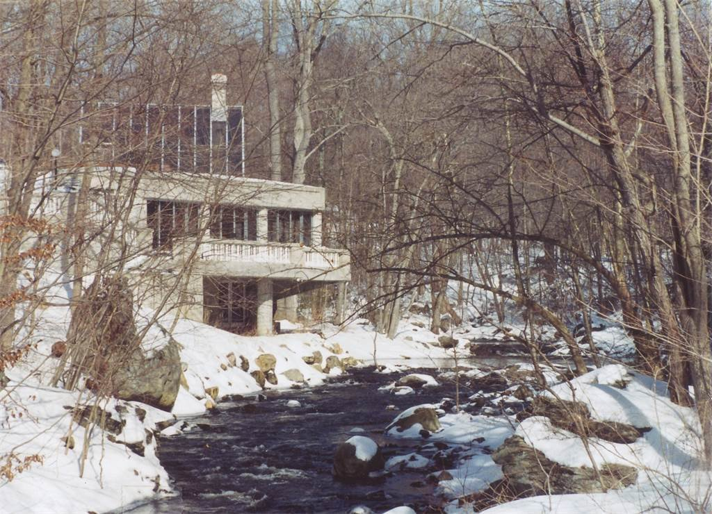 """Shown here is an archival photo of the house during the winter season. Black has sometimes been referred to as the """"Sixth of the Harvard Five,"""" the architects that made history by leading the modern design movement that flourished in the area.  Photo 5 of 11 in The One-of-a-Kind Home of the Late Architect John Black Lee Drops to $750K"""
