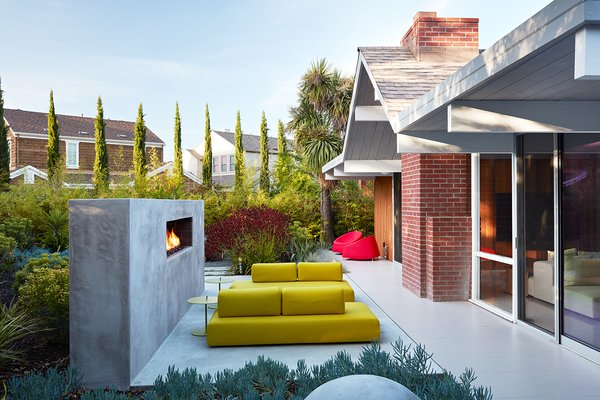 Same Bones, New Materials—A Double Gable Eichler Gets a Dashing Update - Photo 9 of 9 - Outer Space Landscape Architects built a custom fireplace in the backyard, which acts as a backstop for the seating area.