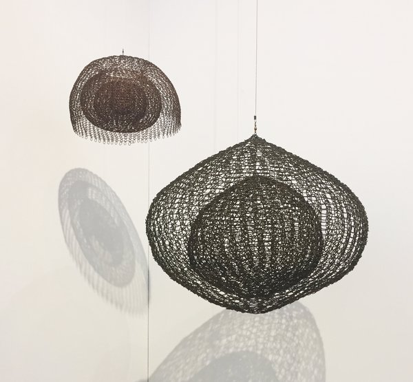 Based in New York, David Zwirner presented a hanging sculpture by Ruth Asawa (1926-2013), the internationally respected sculptor who first learned how to draw in a Japanese-American internment camp during World War II. Hailing from the 1980s, Untitled S.724 is a single-lobed hanging piece with four layers of continuous form within a form. Though it's made of oxidized copper wire, it gives the impression of being soft and moldable.