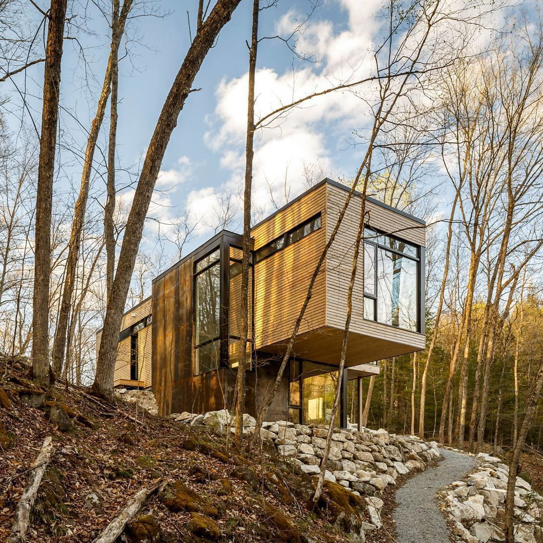 Christopher Simmonds Architect left the eastern white cedar untreated in order to allow it to age with the natural elements. Tagged: Exterior, House, Flat RoofLine, and Wood Siding Material.  Photo 4 of 4 in This Cedar-Wrapped Cabin Mimics its Natural Surroundings With Ease