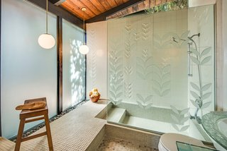 "This Midcentury Home For Sale Is Not Your Regular Ranch House - Photo 8 of 9 - The master bathroom has been updated with George Nelson's sculptured tiles from Pomona Tile Manufacturing Co. The shower wall features the ""Laurel Leaf"" pattern, which is a bas-relief treatment of a single diagonal leaf motif with both raised and recessed areas. The most recent homeowner also installed etched glass to mimic the motif of the tile."
